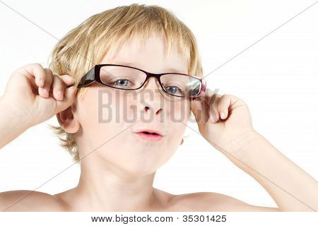 Funny Child In Eyeglasses. Close Up Portrait