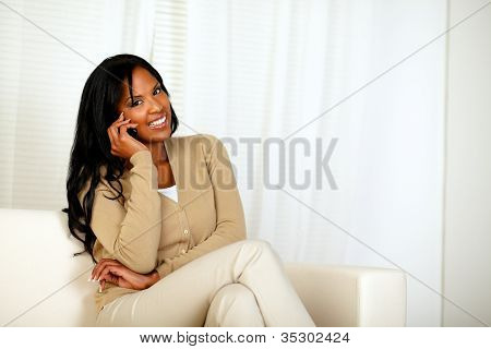 Black Woman Smiling At You While Speaking On Phone