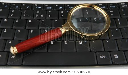 Keyboard And Magnifying Glass