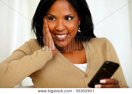 Pensive Black Woman Using Her Cellphone