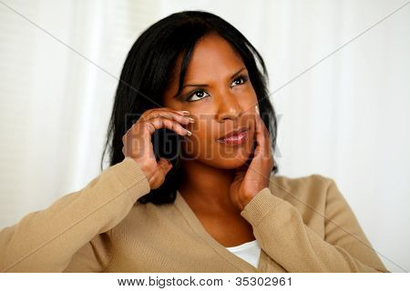 Pensive Young Woman Conversing On Cellphone