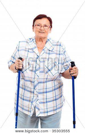Happy Senior Woman With Walking Sticks