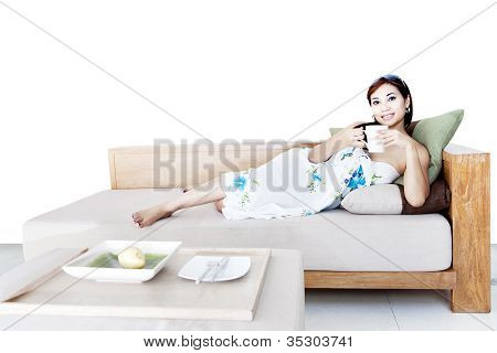 Woman Drink Coffee On Sofa