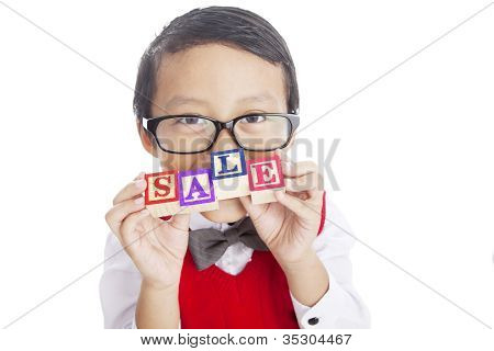 Asian Boy with alphabet blocks