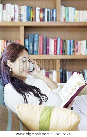 Woman reading and making a phone call