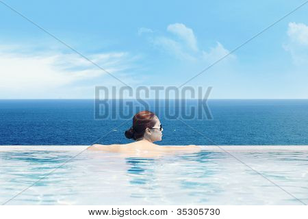 Enjoying Ocean View From The Pool