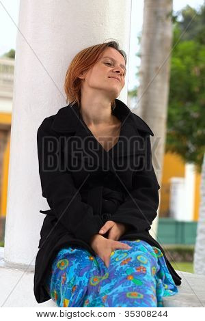 Young Woman Leaning Against a Column