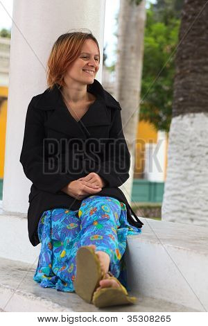Smiling Woman Leaning Against a Column