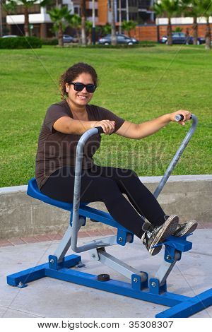 Young Latina Exercising in Park
