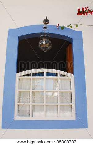 White Window With Pale Blue Trim