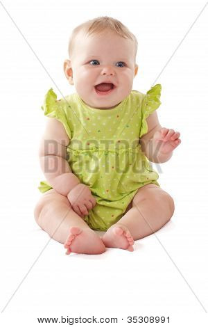 Pretty Laughing Blue Eyed Baby Sits With One Hand Up