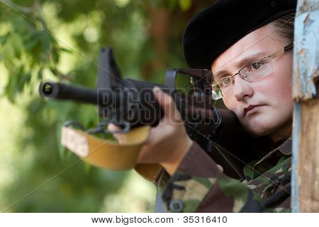 Female Soldier Targeting With A Gun