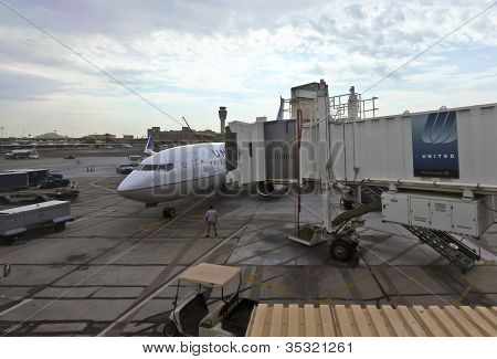 A Jet Bridge Extends To A Commercial Plane On The Tarmac