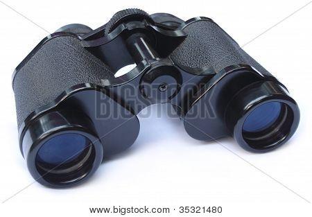 Binoculars over white background