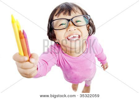 Friendly Little Girl Offers Crayon