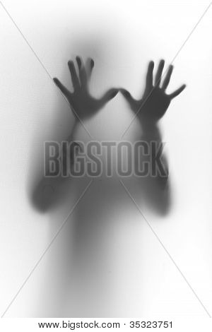 Humand hands, fingers silhouette on glass