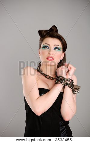 Young Beautiful Woman With Chain