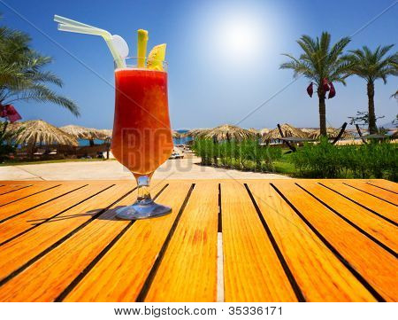 Glass Of Tasty Juice With Pipe On The Table Next To Beach. Egypt