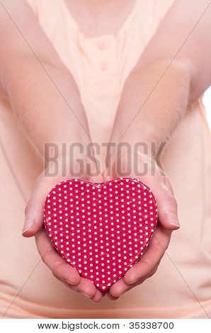 Two Female Hands Are Holding A Red Heart