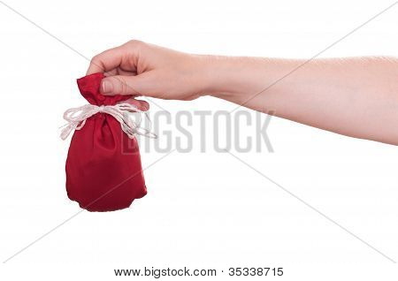 Female Hand Is Holding A Little Red Bag