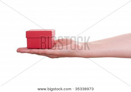 Female Hand Is Holding A Red Gift Box
