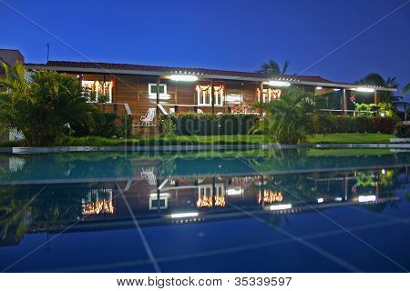 House And Pool View At Night