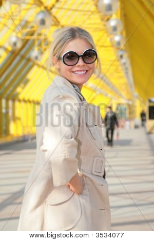 Young Blonde In Sunglasses Smiles