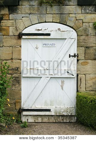 Old White Wooden Door To Walled Garden