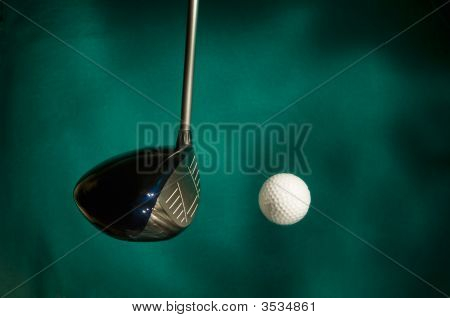 Golf Club Striking Ball