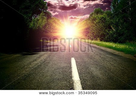 Green Wood And Road Over Blue Sky Wis Sunset
