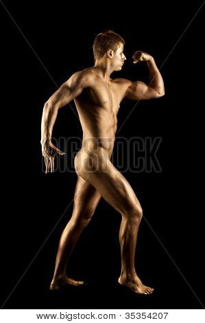 Nude man show athletic body with metal skin