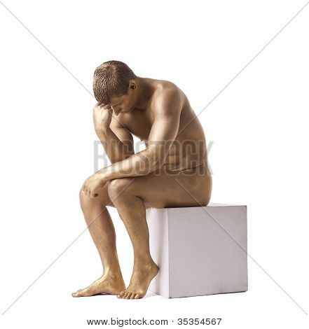 Strong man posing nude studio portrait