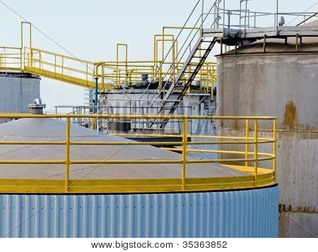 Group of large steel storage tanks at refinery