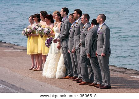 Wedding Party Takes Posed Photo At Lake Michigan Waterfront
