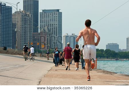 People Being Active Along Lake Michigan Shoreline In Chicago