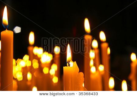 Close Up View Of The Candles Cutting Through The Darkness.