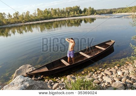 Boat Oarsman On River