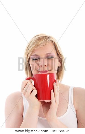 Woman Savouring A Mug Of Hot Coffee
