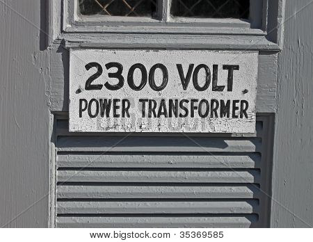 Power Transformator 2300 Volt As Text On Vintage Wooden Signboard, Energy