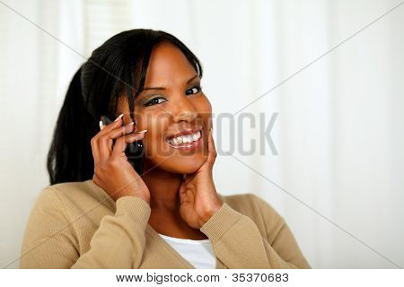 Fresh Woman Looking To You And Talking On Mobile