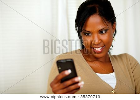 Pretty Woman Reading A Text Message By The Mobile