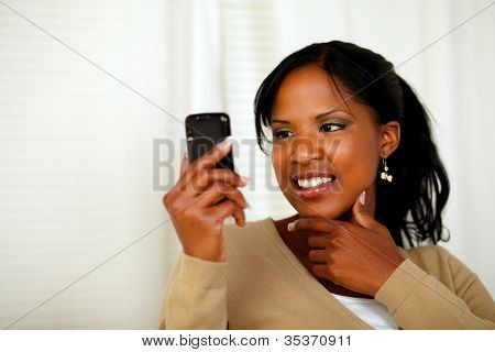 Sophisticated Woman Reading A Message On Cellphone