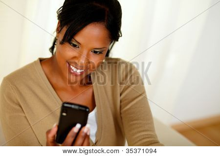 Charming Black Lady Sending A Message By Cellphone