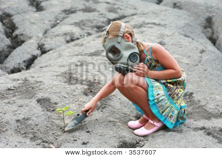 Little Girl With A Tree And Gas Mask