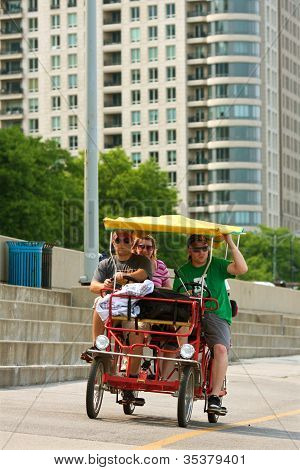 Tourists Pedal A Four-wheeled Cycle Along Chicago's Lake Shore Drive