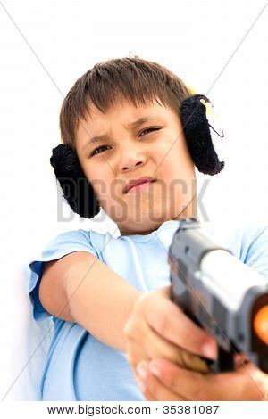 A Little Boy Playing With Toy Gun