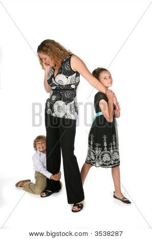 Professional Mother On Phone While Children Tug At Her