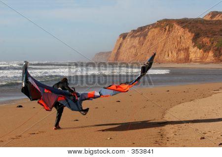 Kite Surfer Walking On The Beach