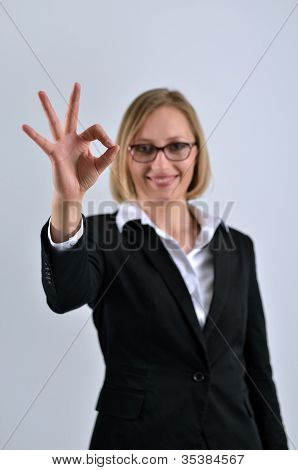 Successful Businesswoman Poses And Hand Gesturing Okay Sign
