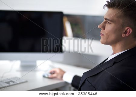 Young Businessman Working With A Computer And Sitting On Couch In Office
